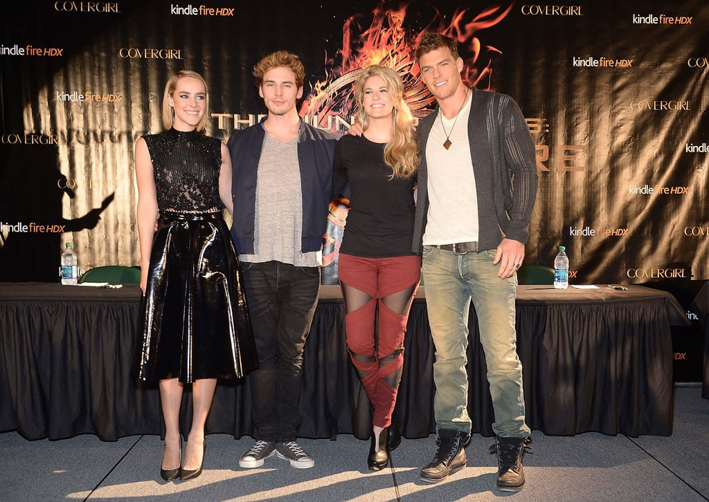 Jena Malone stood next to costars Sam Claflin, Alan Ritchson, and Stephanie Leigh Schlund, who opted for sexy separates and a pair of heels.