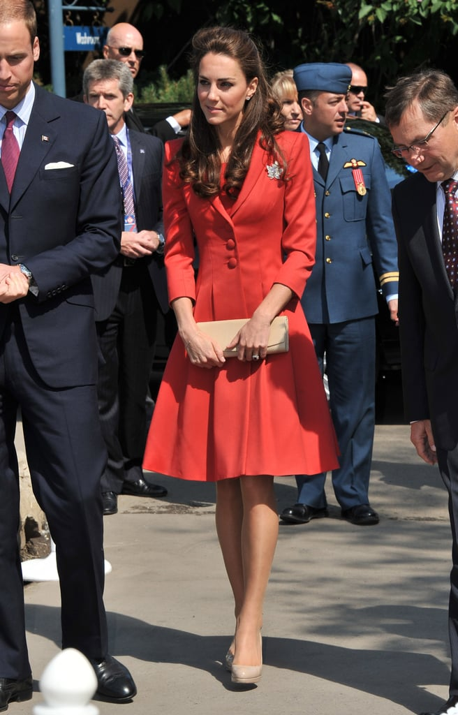 July 8th, 2011 Visiting the ENMAX Conservatory at the Calgary Zoo.    Kate wears a full-skirted red Marianne suit from Catherine Walker with neutral-toned LK Bennett Sledge2 pumps. The Queen's diamond maple leaf pin adorns her left side.