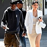 Kylie Jenner Wearing a Slitted Slip Dress and Sneakers With Travis Scott