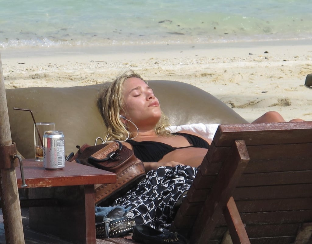 Ashley Olsen hit the beach in St. Barts yesterday to soak up the sun in her bikini alongside boyfriend Justin Bartha. The duo are off on vacation after a quick stop in LA, hanging with friends, dining together, and getting in some boat time. They may have celebrating to do if the recent engagement rumors prove to be true, otherwise it seems that the pair are enjoying a fun and warm pre-holiday getaway.