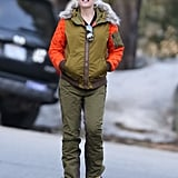 The singer's Winter vacations have meant plenty of opportunities for her to bundle up. Instead of a common black puffer, she picked an army-green style with quilted orange sleeves and a furry hood from her L.A.M.B. for Burton line.