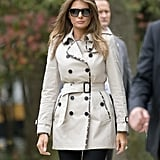 Melania wore a trench coat with a contrast trim to offset her sharp sunglasses when she departed for Maryland with Trump in October 2017.