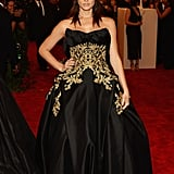 Ashley Greene chose a black-and-gold strapless Marchesa ball gown with Christian Louboutin shoes and Harry Winston yellow diamonds for the Met Gala festivities.