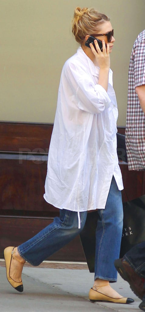 Ashley Olsen talked on her cell today as she left an NYC hotel wearing a pair of ballet flats and a button-up shirt. The designer, along with her sister and business partner Mary-Kate, has been stationed in the big city lately focusing on their many stylish projects. Their sibling Elizabeth, meanwhile, carries on the Olsen family's acting torch and recently brought her movie Martha Marcy May Marlene to the Cannes Film Festival. Ashley and Mary-Kate didn't join her on the trip but sent Elizabeth on her way with outfits from The Row to wear on the red carpet. Ashley and Mary-Kate's high-end line has been a financial and critical success, and they continue to expand their stylish empire with eyewear and the online-shopping venture called StyleMint. The driven duo also continue to support their fellow fashion folks as members of the CFDA and joined Diane von Furstenberg for the organization's biannual membership just last week.