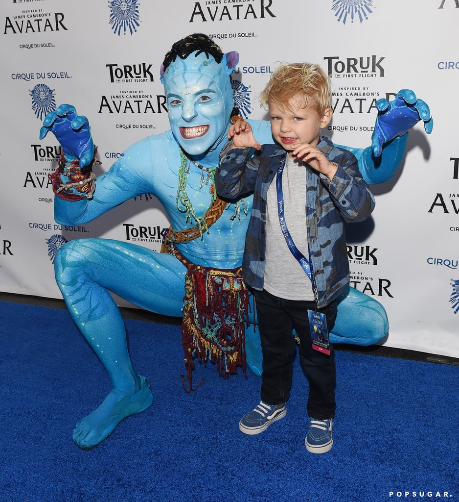 Fergie and Josh Duhamel may have one of the cutest kids in Hollywood. On Friday night, Josh took his son to the new Avatar-inspired Cirque du Soleil show in LA, but it was little Axl who ended up stealing the spotlight. Not only did Axl look adorable in a camo button-up shirt and jeans, but as he posed for pictures with one of the characters, Axl growled and threw up his claws, making for some incredibly sweet moments. Josh also got in on the fun and snapped a few shots with the cast, although judging by the look on Axl's face, the 3-year-old clearly had the better night.       Related:                                                                                                           Axl Duhamel Is Growing Up So Fast! See Fergie and Josh's Cutest Family Pics
