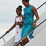 Michelle wearing a gathered turquoise dress on her way to Panama City, Florida.