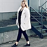 Black Separates Underneath a Fuzzy White Coat With Eye-Catching Ankle Boots