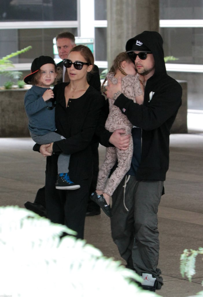 Nicole Richie and Joel Madden held on tight to Sparrow Madden and Harlow Madden as they walked through LAX.