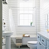 "Simply put, a white or neutral bath has the clean and updated look that most buyers want, especially for a master bath. Katharine says that a buyer-approved look includes ""Calacatta or Carrera, subway tile, and white cabinets."" She has noticed more light blue accents on the market, however, and says that her clients aren't complaining. A subtle blue wall color, tile accent, or painted cabinetry creates a distinctive look without being too personal. While it's risky to veer from neutral, Katharine has noticed that buyers are more comfortable with a ""more modern or non traditional look"" and ""the addition of a bold color or wallpaper"" in a second or third bathroom."