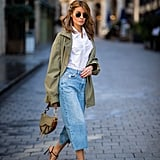 Elevate cropped wide-leg jeans with a utility-inspired anorak, crisp shirt, and heels.