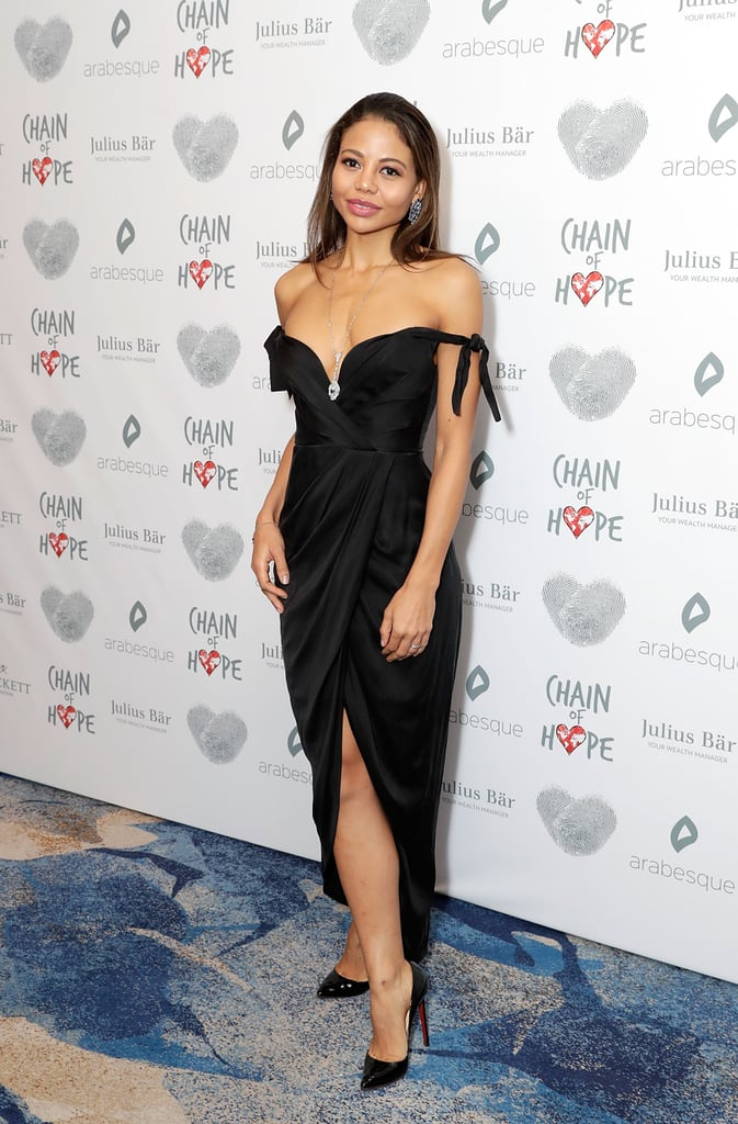 Wearing her favourite combination of off-the-shoulder and leg-split to the Chain of Hope gala ball in 2017.