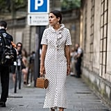 Dress down a polka dot dress with cute flats and a natural bag.