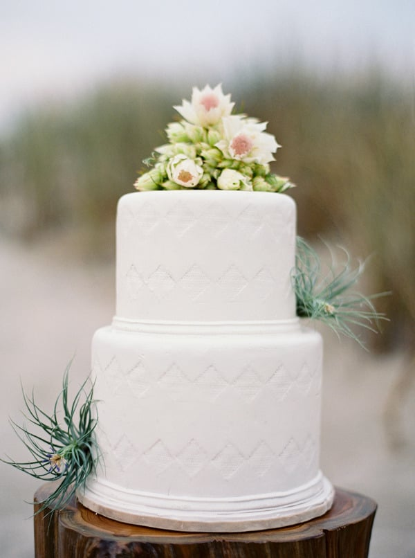 The triangle pattern on this white cake is so subtle, you might not notice it at first — but once you do, you realize what a sweet touch it adds.  Photo by Jose Villa Photography via Style Me Pretty