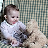 Aw! Princess Charlotte is delighted by a stuffed animal in a photo taken by proud mom Kate.