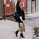 A Long Sequined Skirt, Tailored Jacket, and Neck Scarf