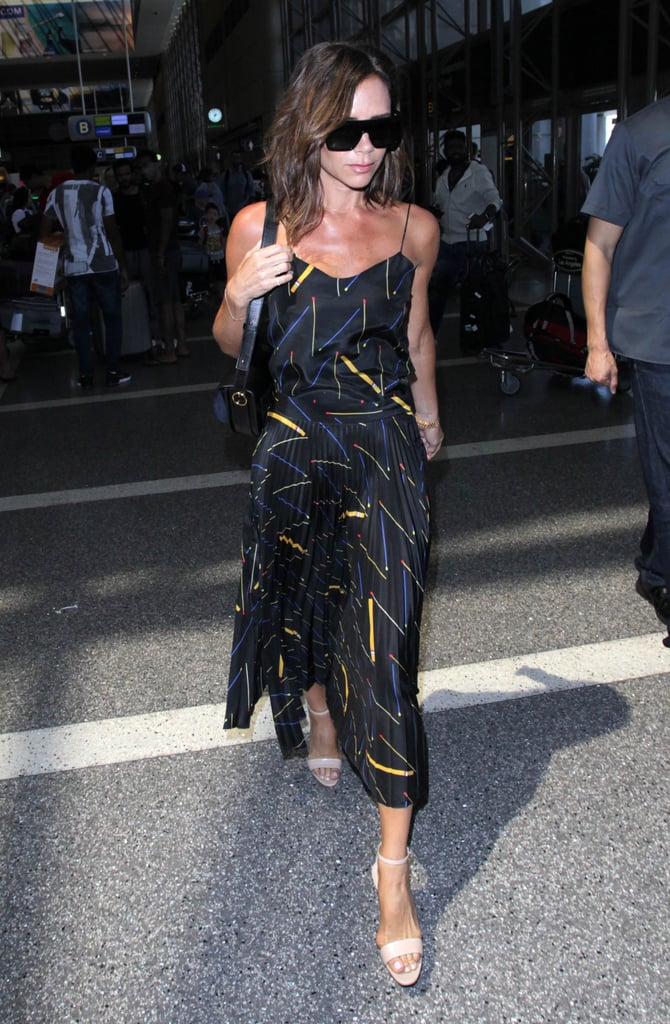 Victoria Beckham in Printed Dress at LAX July 2016