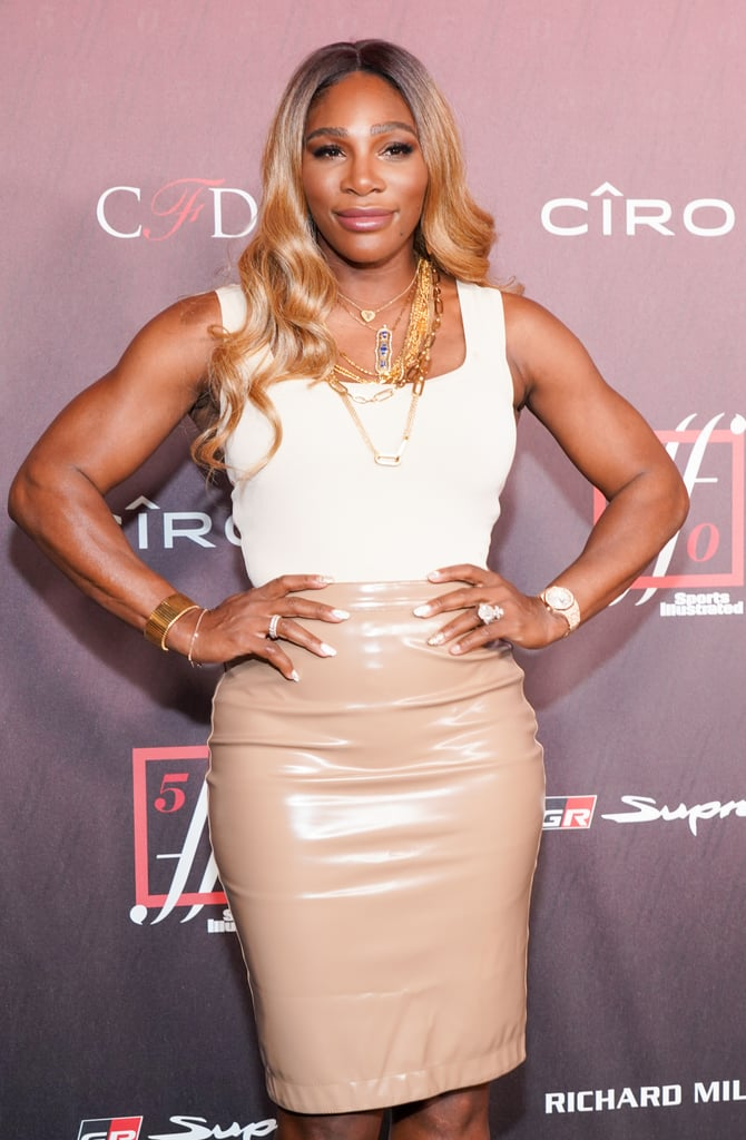 "Serena Williams might be a 23-time Grand Slam tennis champion, but her latest win is this sexy vinyl pencil skirt she wore to Sports Illustrated's Fashionable 50 party. Held on July 18 in Los Angeles, the event honours the most stylish athletes in the sports world. Serena, who is on the cover of the magazine's newest issue, looked absolutely stunning on the red carpet in a skintight head-to-toe beige and gold look. The tennis champion accessorised her $820 Burberry vinyl midi skirt and cream-coloured tank top with a matching pair of strappy tan stilettos, layered gold necklaces, and her stunning engagement ring, of course. Serena also debuted a new honey-coloured hairstyle, adding a sun-kissed finish to her already glamorous look.  ""My whole career has been really about tennis and fashion,"" Serena said in an interview with Sports Illustrated. ""I always try to make a statement when I walk out on the court, to be bold and to be unique and to kind of transcend. I always try to send the message of just being confident and being fierce."" Take a look at Serena's totally fierce red carpet look ahead and shop her exact skirt, too."