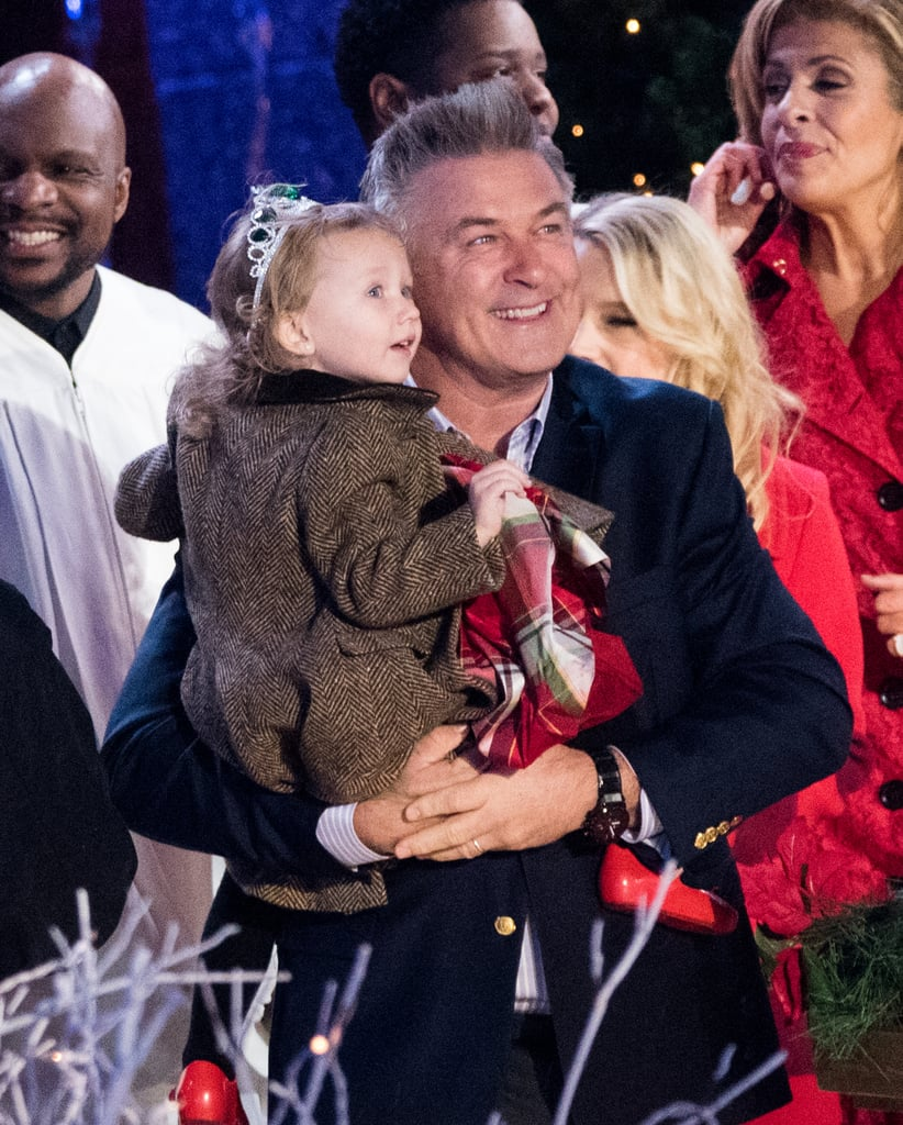 While you might think that the center of attention at the 84th annual Rockefeller Center Christmas Tree Lighting would be the massive tree, you'd be wrong. Alec Baldwin attended the ceremony on Wednesday night along with his 3-year-old daughter, Carmen Gabriela, who was easily the star of the show. She stared up at the tree in wonder and goofed off in her father's arms, even honking his nose at one point in front of New York City Mayor Bill de Blasio. Although Alec's wife, Hilaria, wasn't there, the adorable father-daughter pair was joined by Saturday Night Live star Kate McKinnon, as well as Today show hosts Hoda Kotb and Matt Lauer, as they pushed the giant button to light up the iconic Christmas tree.        Related:                                                                Alec and Hilaria Baldwin Welcome Their Third Child                                                                   The Baldwin Family Takes Over the Mission: Impossible Red Carpet in NYC