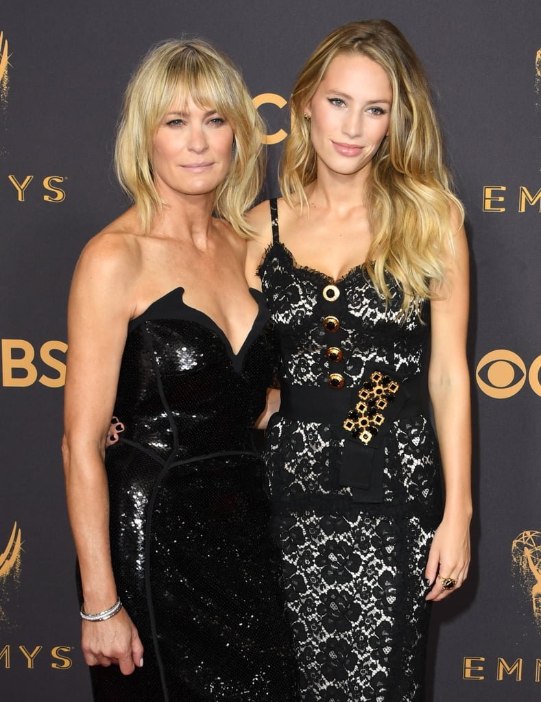Robin Wright stepped onto the Emmys red carpet on Sunday looking like a vision in black — and by her side, also sporting a gorgeous black gown, was her stunning daughter, Dylan Penn. The 26-year-old model and actress is the first child of Robin and her ex-husband Sean Penn, and was all smiles while posing with her mom, who was nominated for outstanding lead actress in a drama series for her incredible role as Claire Underwood in House of Cards. In 2015, we got a glimpse of the lookalike duo on the beach during a getaway in Mexico. Keep reading to see their gorgeous mother-daughter outing at the Emmys!