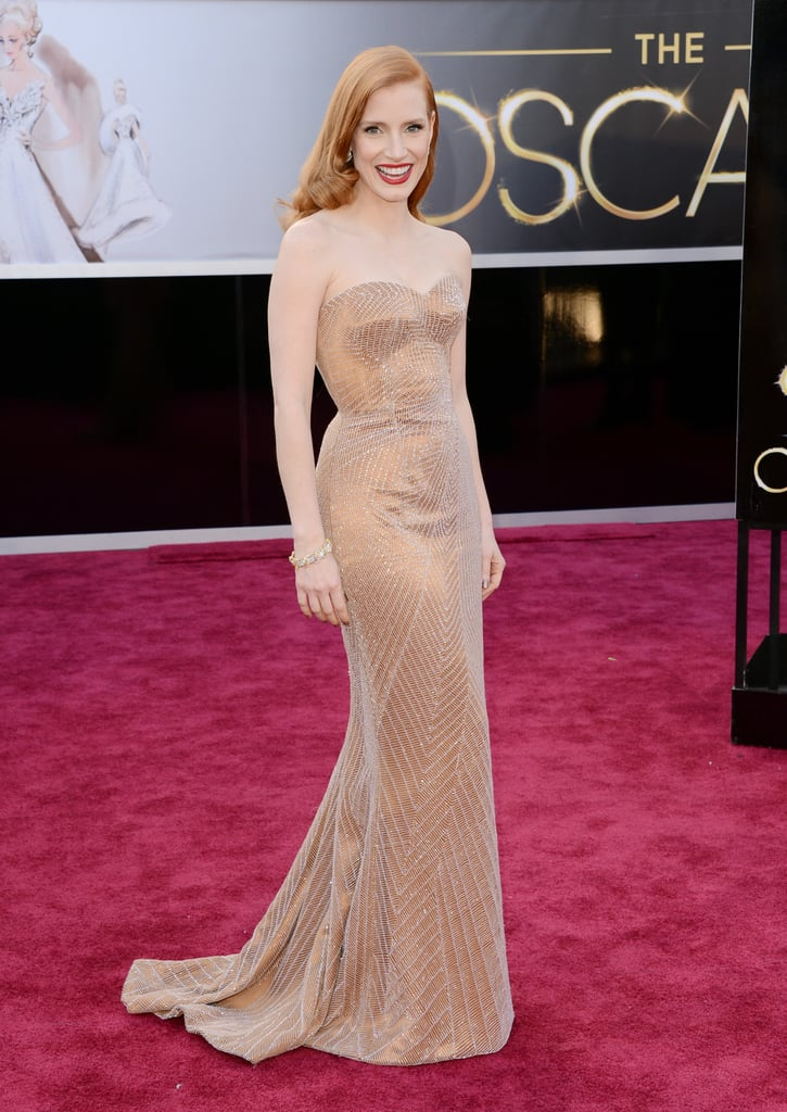 She wore a custom Armani Prive dress, Christian Louboutin heels, and Harry Winston jewels to the 2013 Academy Awards.