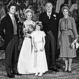 """Lilian added a feather-strewn hat to this shantung silk coat dress with bell sleeves when she married Prince Bertil of Sweden, then heir to the throne, on Dec. 7, 1976. The couple had waited over 30 years to say """"I do,"""" but the bride's pick has stood the test of time. It recently starred in an exhibition of Swedish royal wedding dresses."""