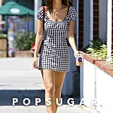 For a stroll in LA, the star slipped into an easy cap-sleeve gingham minidress from Reformation.