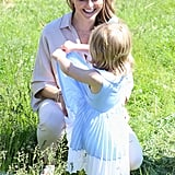 The royal mom couldn't contain her joy as she played in the grass with her daughter, Leonore, in 2016.