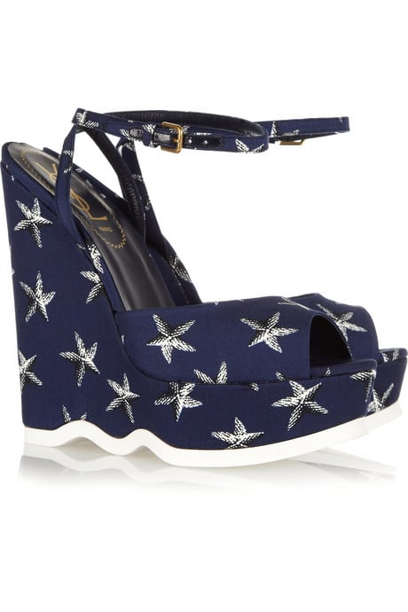 A nautical-inspired print brings ample fun to even our most casual of looks.  Yves Saint Laurent Riviera Starfish Print Wedges ($745)