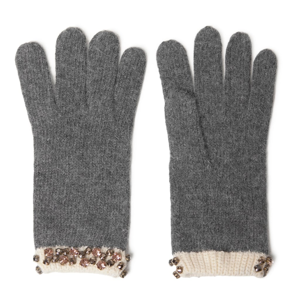 For just a hint of flair, try on a pair of Zara's cuff and stones gloves ($26), which prove girlie and functional.