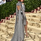 For the 2018 Met Gala, Zendaya wore a spectacular silver Versace dress that looked like a knight's armour with the metal shoulder pads and chain details.