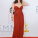 Kat Dennings wore a sultry red strapless gown by J. Mendel at the 2012 Emmys.