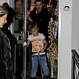 Gavin Rossdale left a toy store with Kingston Rossdale on his scooter.