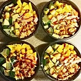 Poke bowl with salmon, crab, cucumbers, rice, mangoes, and hot sauce.