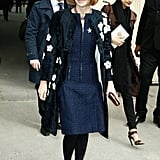 Anna Wintour made her way into Chanel's show at PFW in a floral coat and a navy tweed dress.