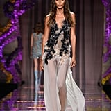 They Watched Joan Smalls Take the Runway in a Sheer Textured Dress