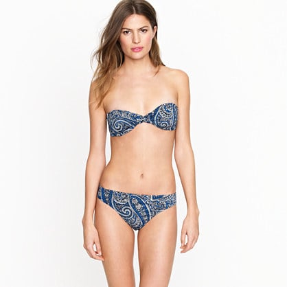 A classic blue paisley print lends a boho feel to this bandeau bikini.