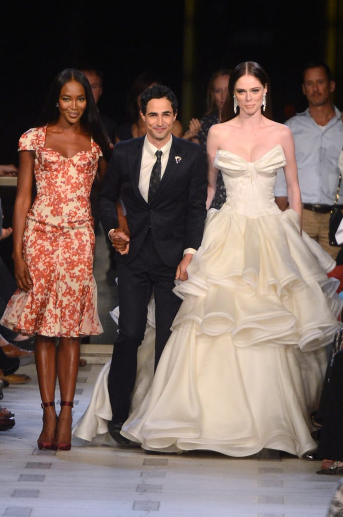 The designer, in stride with Naomi Campbell and Coco Rocha, at his Spring '13 runway show. While we might not see the exact same level of couture eveningwear for Zac Zac Posen, we can look forward to the same attention to architectural tailoring and beautifully feminine dresses.