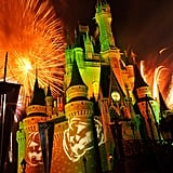 Jack-o'-lanterns light up the castle.