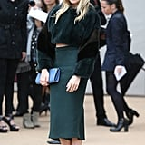 Sienna Miller took the Burberry Prorsum show in a gorgeous green ensemble, including a cropped fur coat and a midi skirt.