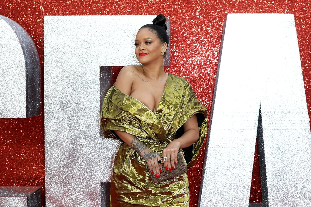 Rihanna arrived on the red carpet in London on Wednesday for the UK premiere of Ocean's 8, and honestly, Charlie Bucket must feel attacked. The singer and actress channeled one of Willy Wonka's golden tickets in a metallic gold Poiret dress (that would definitely look like a Hefty bag on anyone else) and struck a series of sexy poses for photographers.  Her Royal Bad Gal has been busier than ever this year, from her Fenty Beauty collection and Clara Lionel Foundation to hitting the big screen alongside Sandra Bullock and Cate Blanchett in the highly anticipated heist film, which was released last week. Something tells us she's not going to slow down anytime soon. Keep reading to see her gilded red carpet look.