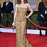 Spoiler alert! Jennifer Garner must have known husband Ben Affleck's film Argo would take home honors when she chose this statuesque lace and sequin Oscar de la Renta gown. Brian Atwood pumps, a chain-link bracelet, and romantic curls completed her golden goddess look.