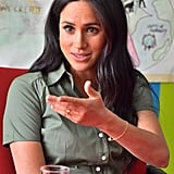 Meghan Markle Wearing an Evil Eye Bracelet and Green Shirtdress