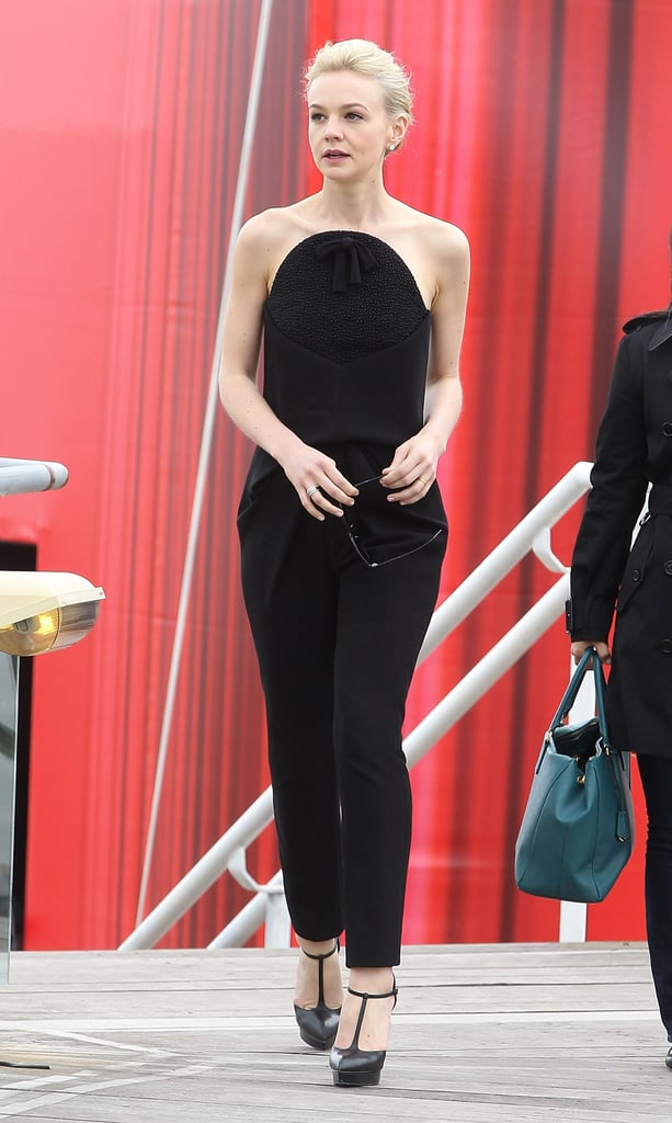 Carey Mulligan attended The Great Gatsby's photocall in a black jumpsuit from Alexander Wang's debut collection for Balenciaga and black T-strap sandals from Saint Laurent.