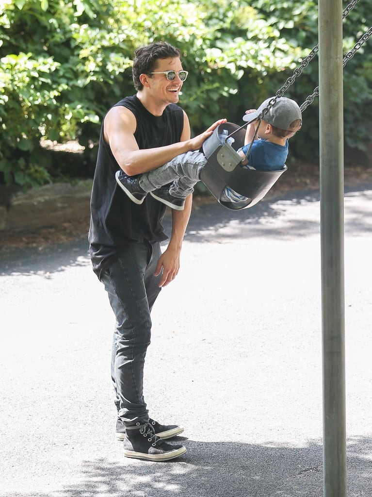 Orlando pushed Flynn in a swing in Central Park on July 6.
