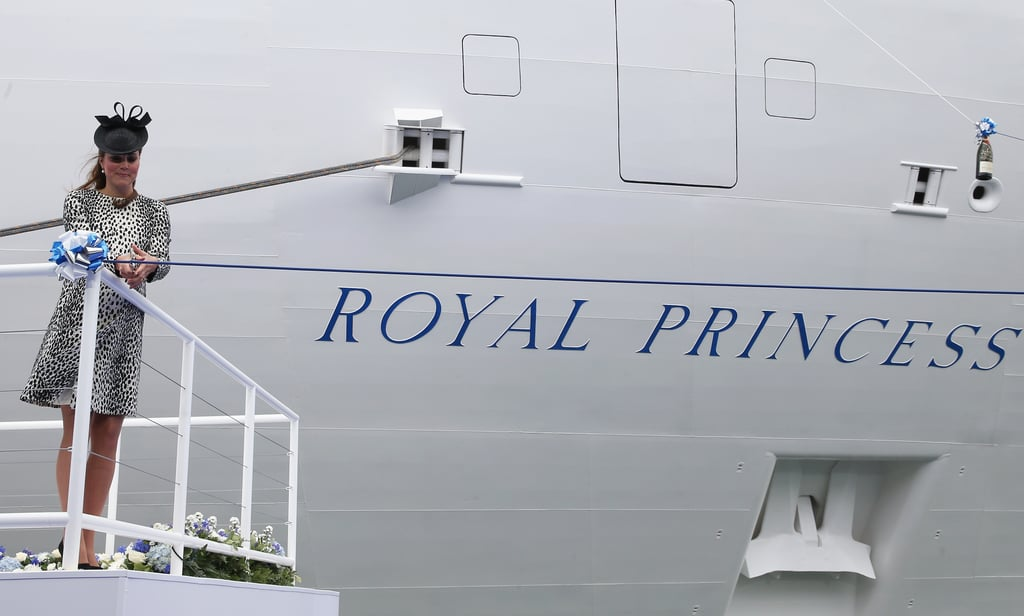 Kate Middleton prepared to cut a ribbon to release a champagne bottle to christen the new ship.