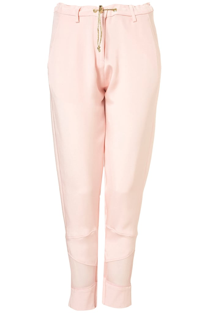 The sheer panels at the trouser hem provide a dynamic element to this sleek pant shape. Topshop Sheer Panel Silk Trousers by Unique** ($220)