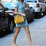 Blue, peach, and yellow made a chic combination with this ladylike ensemble.