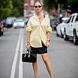 Style a button-down shirt over a miniskirt and finish with pumps at work.