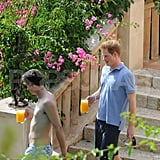 Prince Harry chatted with a guy friend.