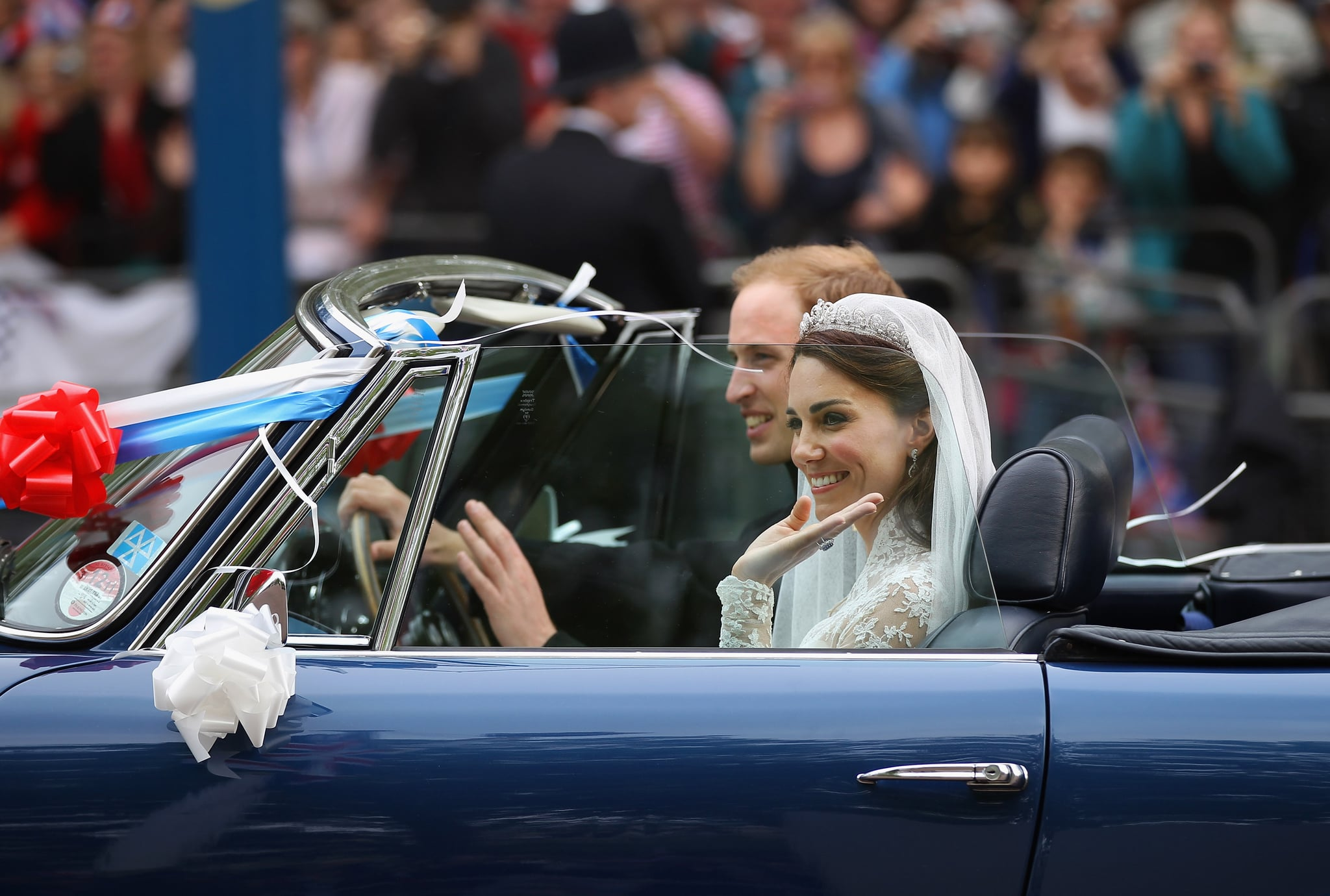 LONDON, ENGLAND - APRIL 29:  Prince William, Duke of Cambridge and Catherine, Duchess of Cambridge drive from Buckingham Palace in a decorated sports car on April 29, 2011 in London, England. The marriage of the second in line to the British throne was led by the Archbishop of Canterbury and was attended by 1900 guests, including foreign Royal family members and heads of state. Thousands of well-wishers from around the world have also flocked to London to witness the spectacle and pageantry of the Royal Wedding.    (Photo by Jeff J Mitchell/Getty Images)